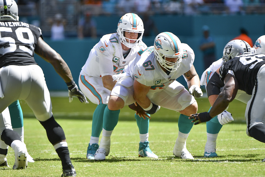 Ryan Tannehill #17 of the Miami Dolphins before the snap during the third quarter against the Oakland Raiders at Hard Rock Stadium on September 23, 2018 in Miami, Florida.