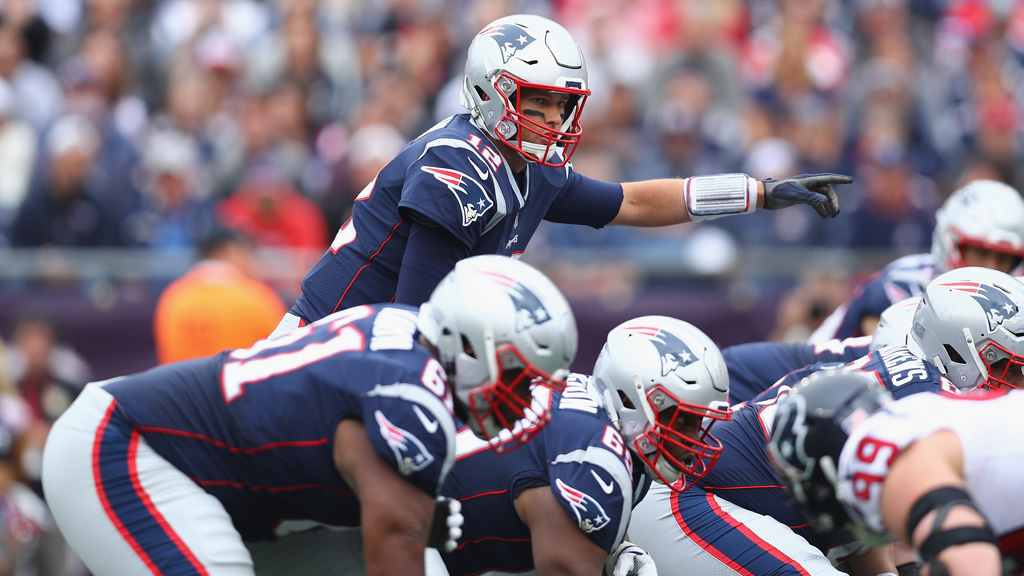 Tom Brady #12 of the New England Patriots gestures at the line of scrimmage during the first half against the Houston Texans at Gillette Stadium on September 9, 2018 in Foxborough, Massachusetts.