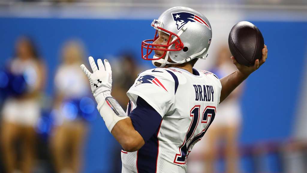 Quarterback Tom Brady #12 of the New England Patriots looks to throw the ball against the Detroit Lions during the first half at Ford Field on September 23, 2018 in Detroit, Michigan.