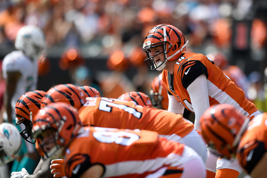Andy Dalton #14 of the Cincinnati Bengals calls a play at the line of scrimmage during the first quarter of the game against the Miami Dolphins at Paul Brown Stadium on October 7, 2018 in Cincinnati, Ohio.