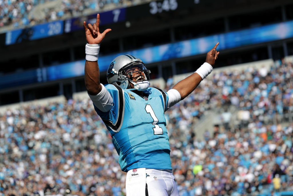 Cam Newton #1 of the Carolina Panthers celebrates a touchdown against the Baltimore Ravens in the fourth quarter during their game at Bank of America Stadium on October 28, 2018 in Charlotte, North Carolina.