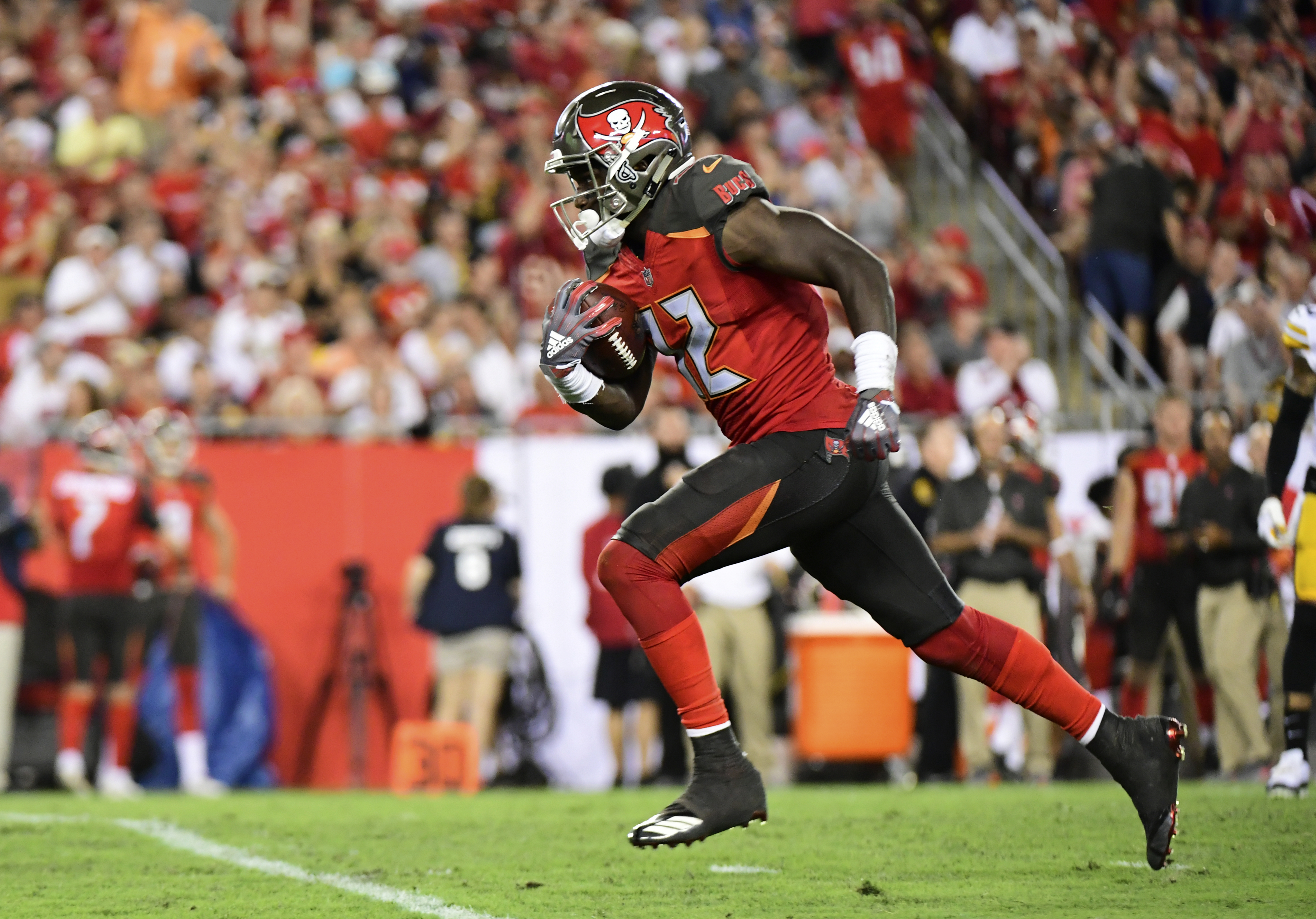 Chris Godwin #12 of the Tampa Bay Buccaneers runs the ball in the third quarter against the Pittsburgh Steelers on September 24, 2018 at Raymond James Stadium in Tampa, Florida.