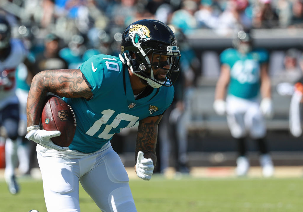 Donte Moncrief #10 of the Jacksonville Jaguars runs for yards after catch during the second half against the Houston Texans at TIAA Bank Field on October 21, 2018 in Jacksonville, Florida.