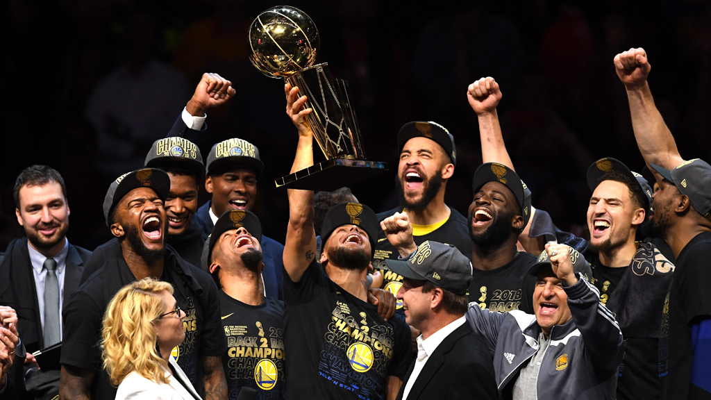 Stephen Curry #30 of the Golden State Warriors celebrates with the Larry O'Brien Trophy after defeating the Cleveland Cavaliers during Game Four of the 2018 NBA Finals at Quicken Loans Arena on June 8, 2018 in Cleveland, Ohio. The Warriors defeated the Cavaliers 108-85 to win the 2018 NBA Finals.