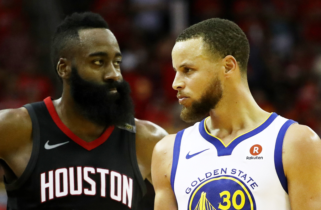 Stephen Curry #30 of the Golden State Warriors reacts as James Harden #13 of the Houston Rockets looks on in the third quarter of Game Seven of the Western Conference Finals of the 2018 NBA Playoffs at Toyota Center on May 28, 2018 in Houston, Texas.