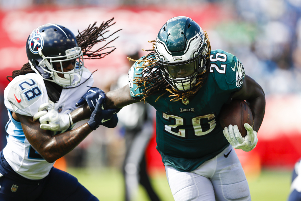 Jay Ajayi #26 of the Philadelphia Eagles runs with the ball while defended by Kendrick Lewis #28 of the Tennessee Titans in the third quarter at Nissan Stadium on Sept. 30, 2018 in Nashville, Tennessee.