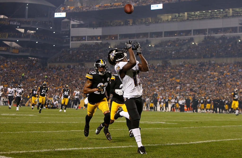 John Brown #13 of the Baltimore Ravens makes a catch for a 33 yard touchdown in the first quarter during the game against the Pittsburgh Steelers at Heinz Field on September 30, 2018 in Pittsburgh, Pennsylvania.