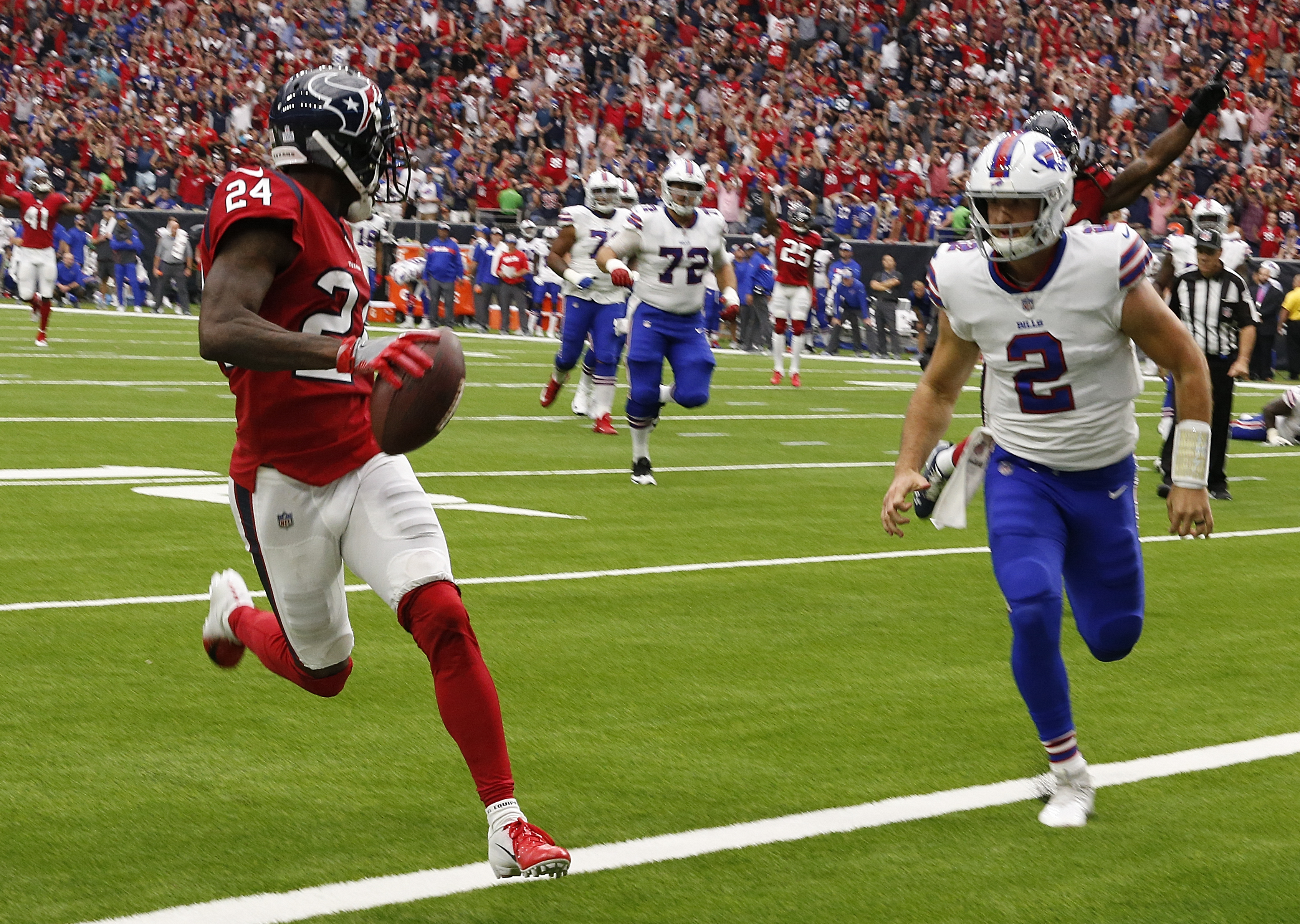 Johnathan Joseph #24 of the Houston Texans scores on an interception as Nathan Peterman #2 of the Buffalo Bills is late on the coverage at NRG Stadium on October 14, 2018 in Houston, Texas.