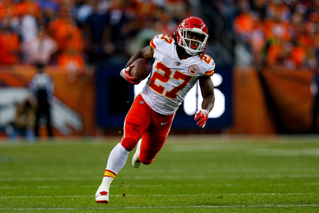 Running back Kareem Hunt #27 of the Kansas City Chiefs rushes in the open field against the Denver Broncos in the first quarter of a game at Broncos Stadium at Mile High on October 1, 2018 in Denver, Colorado.