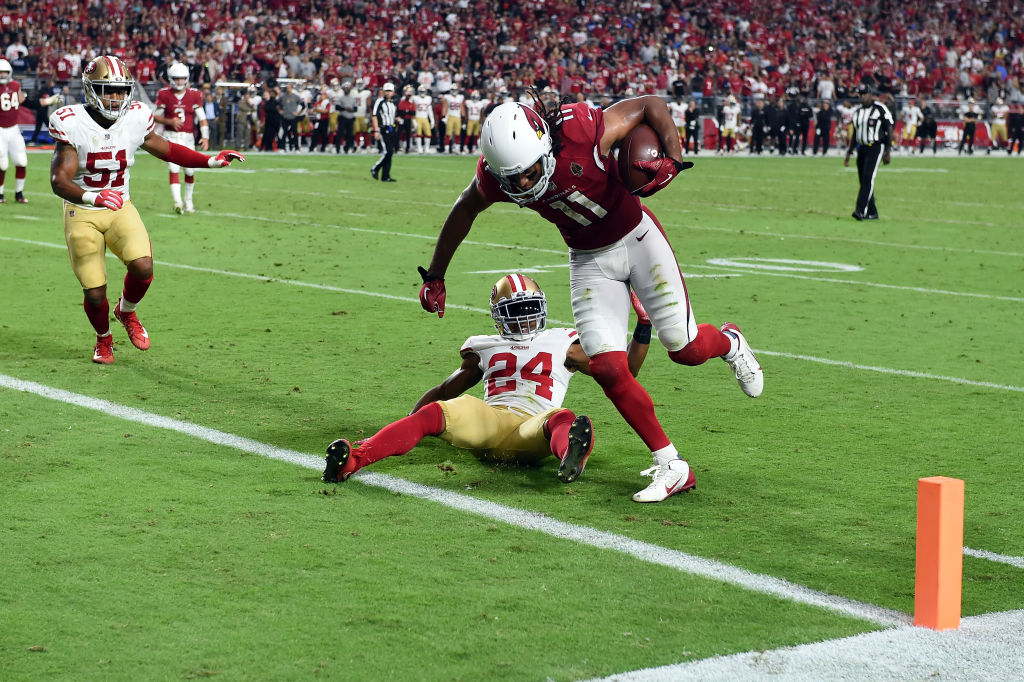 Wide receiver Larry Fitzgerald #11 of the Arizona Cardinals scores a two point conversion while being defended by defensive back K'Waun Williams #24 of the San Francisco 49ers during the fourth quarter at State Farm Stadium on October 28, 2018 in Glendale, Arizona.