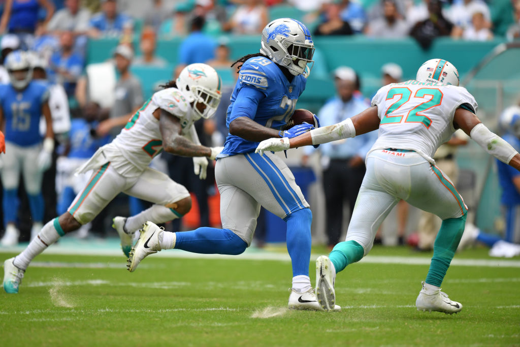 LeGarrette Blount #29 of the Detroit Lions runs with the ball in the third quarter against the Miami Dolphins at Hard Rock Stadium on October 21, 2018 in Miami, Florida.