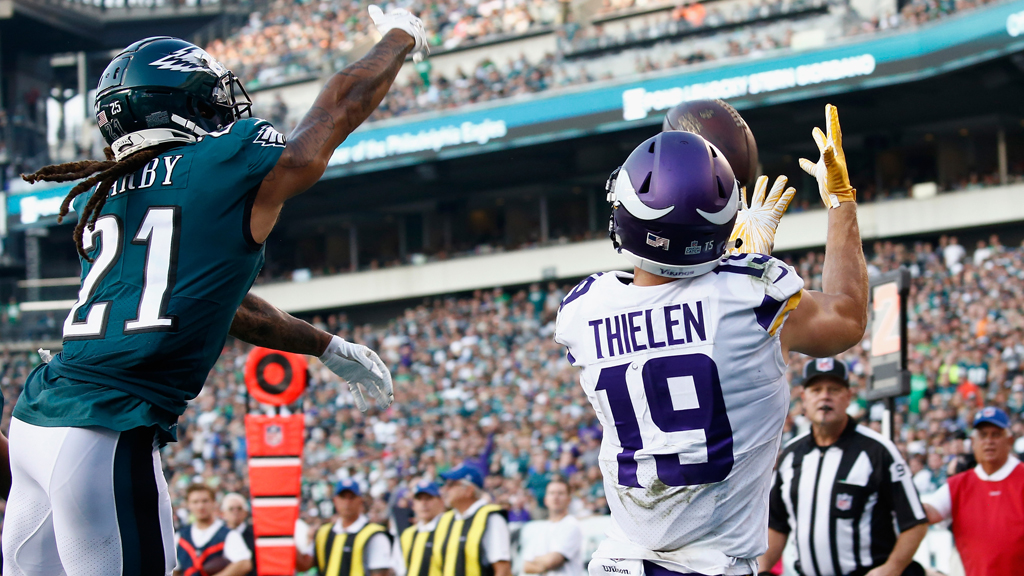 Wide receiver Adam Thielen #19 of the Minnesota Vikings makes a catch against cornerback Ronald Darby #21 of the Philadelphia Eagles to run 3 yards for a touchdown during the second quarter at Lincoln Financial Field on October 7, 2018 in Philadelphia, Pennsylvania.