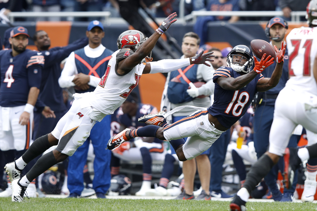 Taylor Gabriel #18 of the Chicago Bears receives the pass in the second quarter against the Tampa Bay Buccaneers at Soldier Field on September 30, 2018 in Chicago, Illinois.