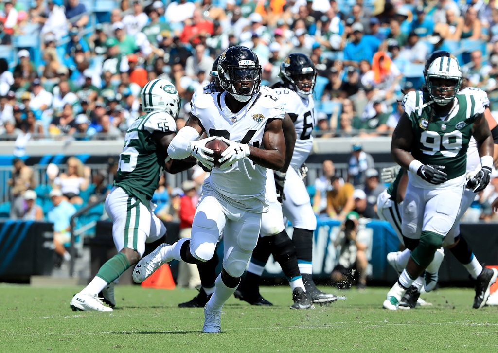 T.J. Yeldon #24 of the Jacksonville Jaguars runs for yardage during the game against the New York Jets on September 30, 2018 in Jacksonville, Florida.