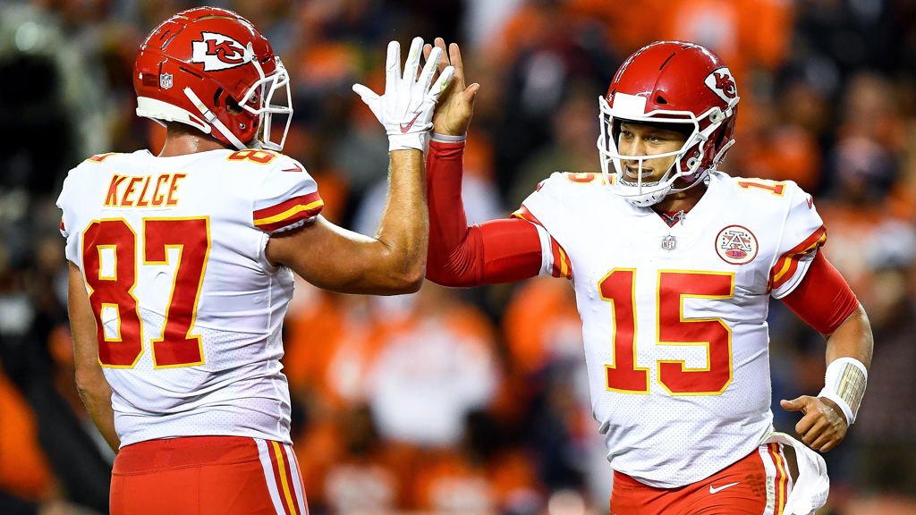 Quarterback Patrick Mahomes #15 of the Kansas City Chiefs celebrates with tight end Travis Kelce #87 after scoring a second quarter rushing touchdown against the Denver Broncos at Broncos Stadium at Mile High on October 1, 2018 in Denver, Colorado.