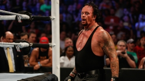 The Undertaker recovers during his fight against Brock Lesner at the WWE SummerSlam 2015 at Barclays Center of Brooklyn on August 23, 2015 in New York City.