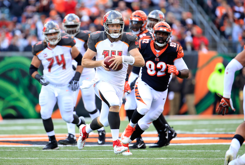 Ryan Fitzpatrick #14 of the Tampa Bay Buccaneers runs with the ball against the Cincinnati Bengals at Paul Brown Stadium on October 28, 2018 in Cincinnati, Ohio.