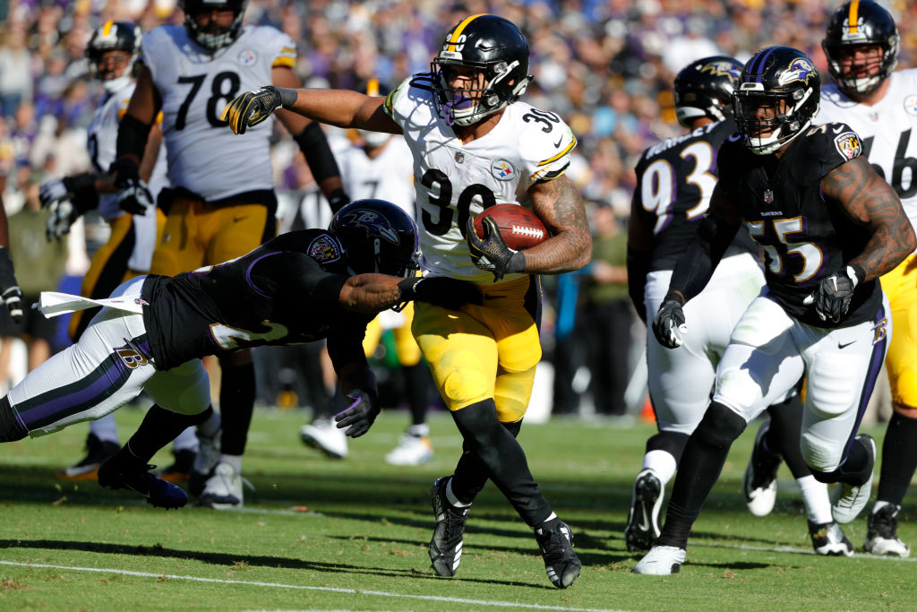 Running Back James Conner #30 of the Pittsburgh Steelers runs with the ball in the second quarter against the Baltimore Ravens at M&T Bank Stadium on November 4, 2018 in Baltimore, Maryland.