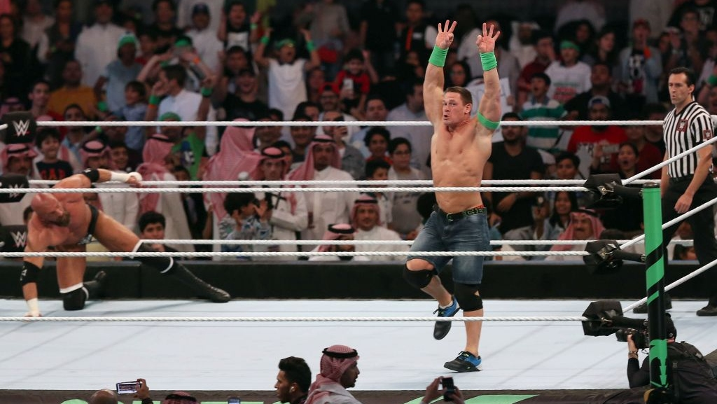 John Cena (R) competes with Triple H (L) during the World Wrestling Entertainment (WWE) Greatest Royal Rumble event in the Saudi coastal city of Jeddah on April 27, 2018.