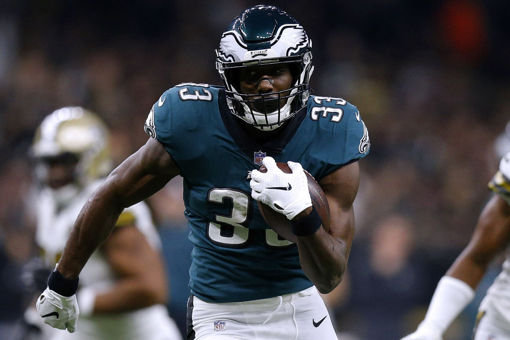 Josh Adams #33 of the Philadelphia Eagles runs with the ball for a touchdown during the first half against the New Orleans Saints at the Mercedes-Benz Superdome on November 18, 2018 in New Orleans, Louisiana.