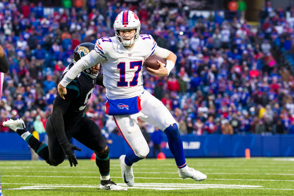 Josh Allen #17 of the Buffalo Bills runs with the ball during the fourth quarter against the Jacksonville Jaguars at New Era Field on November 25, 2018 in Orchard Park, New York. Buffalo defeats Jacksonville 24-21.