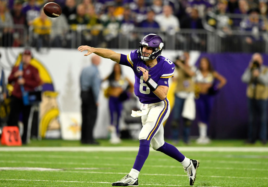 Kirk Cousins #8 of the Minnesota Vikings passes the ball in the first quarter of the game against the Green Bay Packers at U.S. Bank Stadium on November 25, 2018 in Minneapolis, Minnesota.