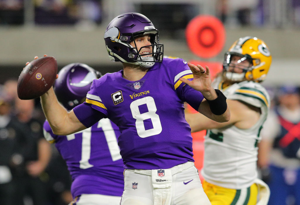 Kirk Cousins #8 of the Minnesota Vikings passes the ball in the third quarter of the game against the Green Bay Packers at U.S. Bank Stadium on November 25, 2018 in Minneapolis, Minnesota.
