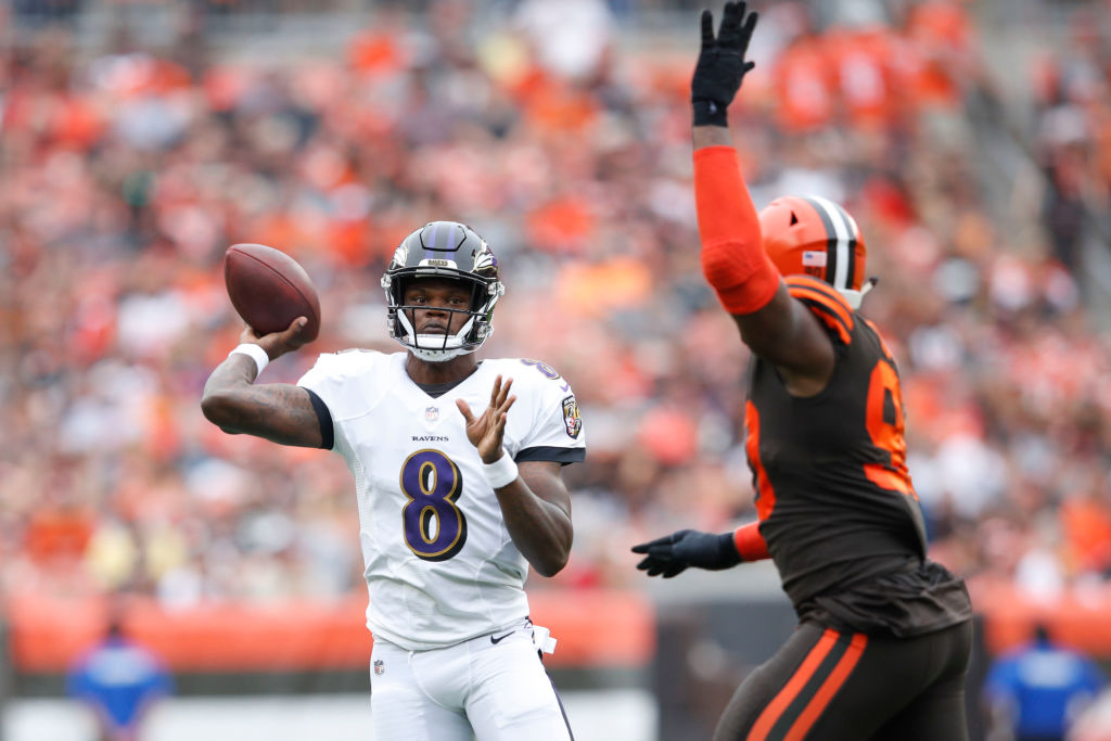 Lamar Jackson #8 of the Baltimore Ravens throws a pass in the first half against the Cleveland Browns at FirstEnergy Stadium on October 7, 2018 in Cleveland, Ohio.