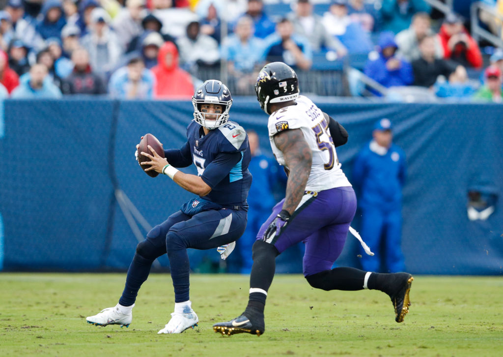 Marcus Mariota #8 of the Tennessee Titans prepares to throw during the second quarter while defended by Terrell Suggs #55 of the Baltimore Ravens at Nissan Stadium on October 14, 2018 in Nashville, Tennessee.