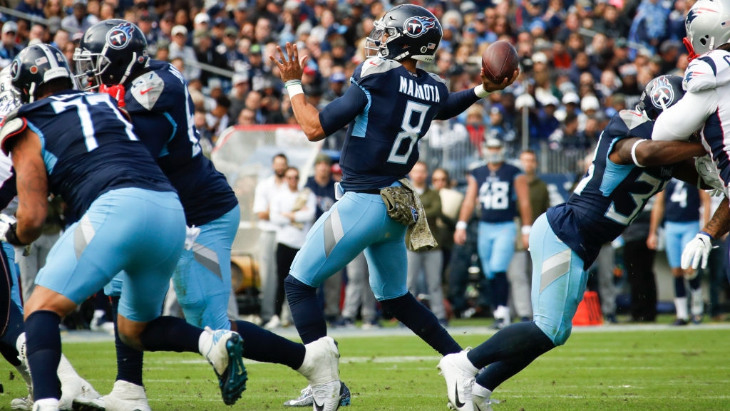 Marcus Mariota #8 of the Tennessee Titans throws a pass against the New England Patriots during the first quarter at Nissan Stadium on November 11, 2018 in Nashville, Tennessee.