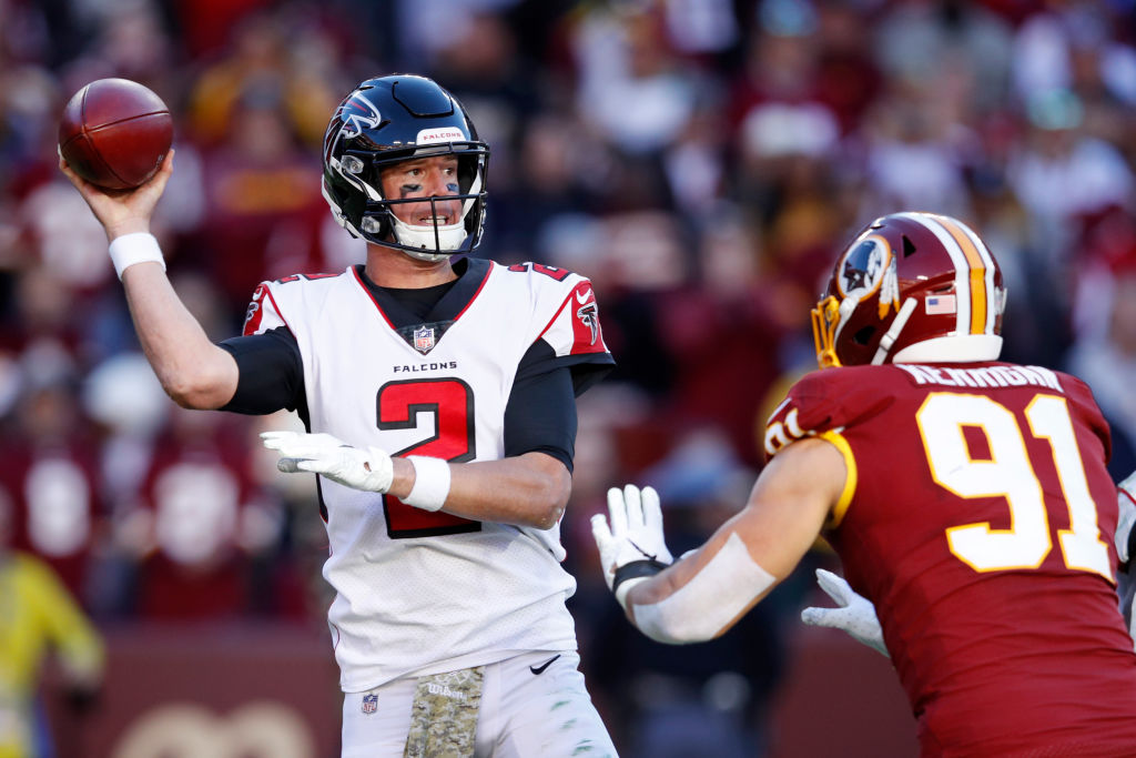 Matt Ryan #2 of the Atlanta Falcons throws a pass while under pressure from Ryan Kerrigan #91 of the Washington Redskins in the third quarter of the game at FedExField on November 4, 2018 in Landover, Maryland. Atlanta won 38-14.