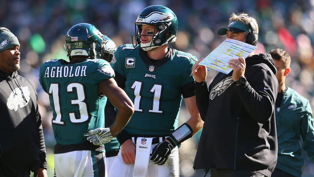 Wide receiver Nelson Agholor #13, quarterback Carson Wentz #11 and head coach Doug Pederson of the Philadelphia Eagles talk as they take on the Carolina Panthers during the third quarter at Lincoln Financial Field on October 21, 2018 in Philadelphia, Pennsylvania. The Carolina Panthers won 21-17.