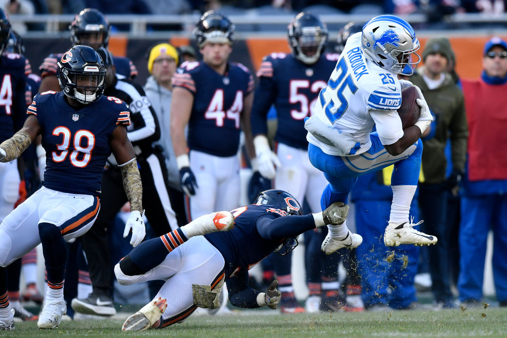 Theo Riddick #25 of the Detroit Lions is hit by Danny Trevathan #59 of the Chicago Bears in the fourth quarter at Soldier Field on November 11, 2018 in Chicago, Illinois. The Chicago Bears defeated the Detroit Lions 34-22.