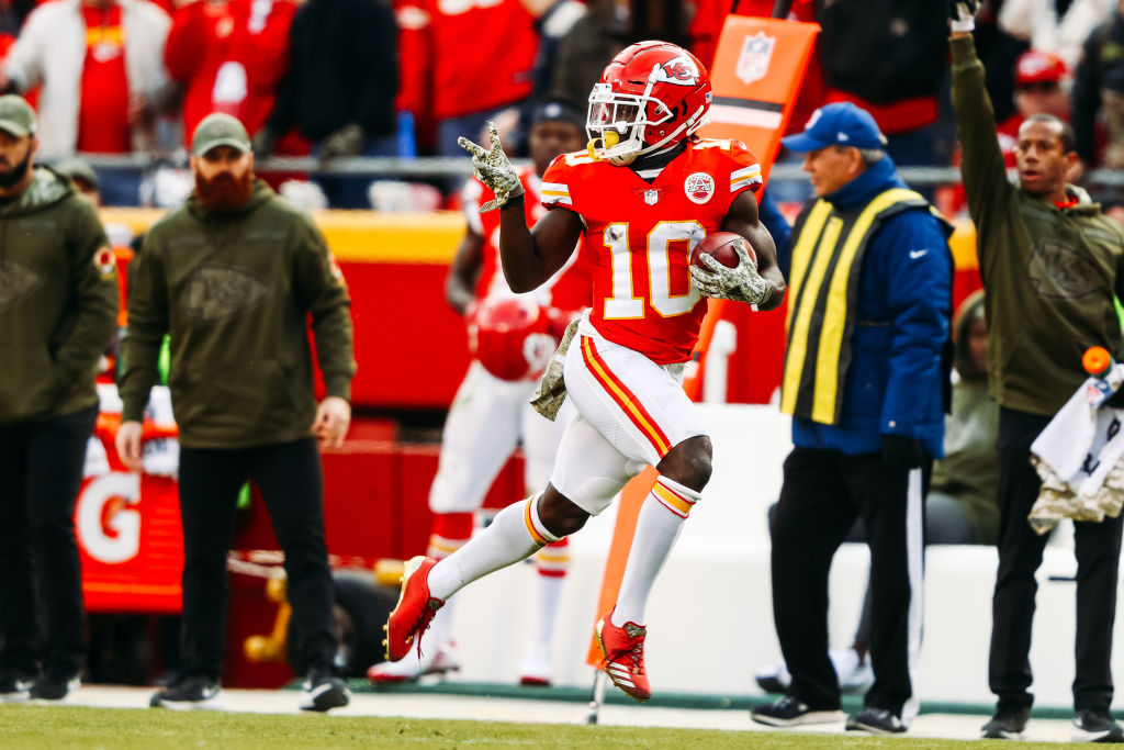 Tyreek Hill #10 of the Kansas City Chiefs celebrates a punt return touchdown that would be called back due to penalty in the fourth quarter of the game against the Arizona Cardinals at Arrowhead Stadium on November 11, 2018 in Kansas City, Missouri.