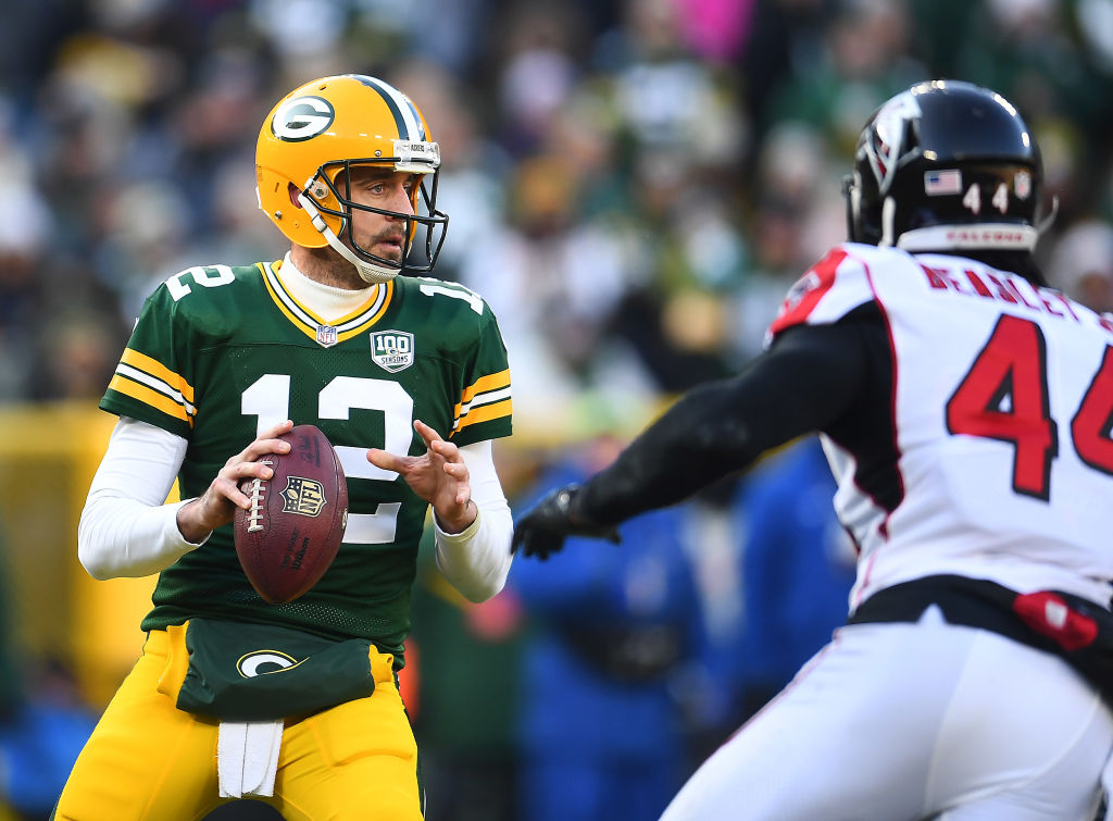 Aaron Rodgers #12 of the Green Bay Packers drops back to pass during the first half of a game against the Atlanta Falcons at Lambeau Field on December 09, 2018 in Green Bay, Wisconsin.