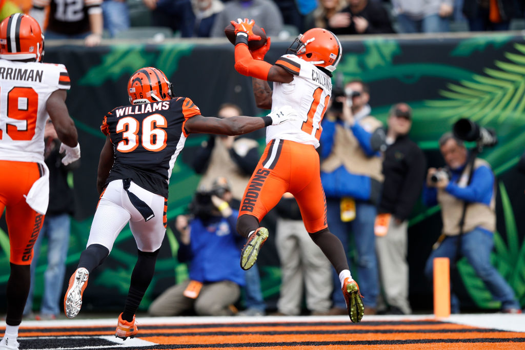 Antonio Callaway #11 of the Cleveland Browns catches a touchdown over the defense of Shawn Williams #36 of the Cincinnati Bengals during the first quarter at Paul Brown Stadium on November 25, 2018 in Cincinnati, Ohio.