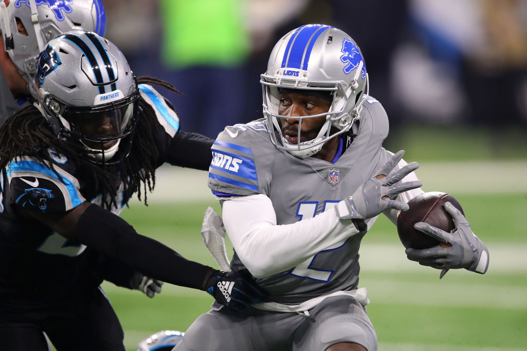 Detroit Lions wide receiver Bruce Ellington #12 runs for yardage against Carolina Panthers cornerback Donte Jackson #26 during the first half at Ford Field on November 18, 2018 in Detroit, Michigan.