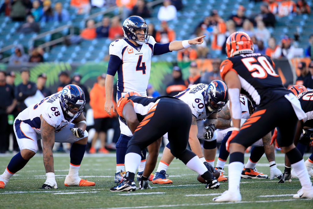 Case Keenum #4 of the Denver Broncos calls a play at the line of scrimmage during the fourth quarter of the game against the Cincinnati Bengals at Paul Brown Stadium on December 2, 2018 in Cincinnati, Ohio. Denver defeated Cincinnati 24-10.