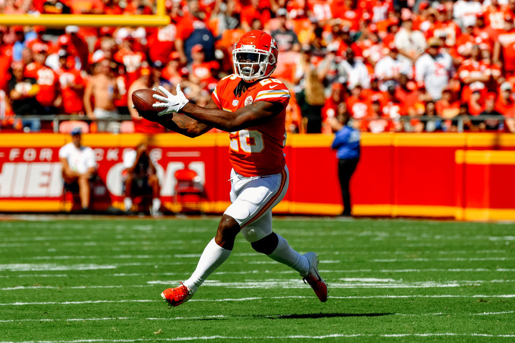 Damien Williams #26 of the Kansas City Chiefs catches a pass after a bobble during the second quarter of the game against the San Francisco 49ers at Arrowhead Stadium on September 23rd, 2018 in Kansas City, Missouri.