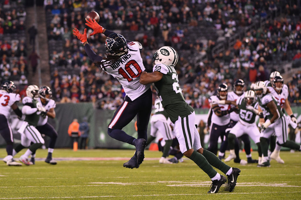 Wide receiver DeAndre Hopkins #10 of the Houston Texans makes a catch against cornerback Trumaine Johnson #22 of the New York Jets in the first quarter at MetLife Stadium on December 15, 2018 in East Rutherford, New Jersey.