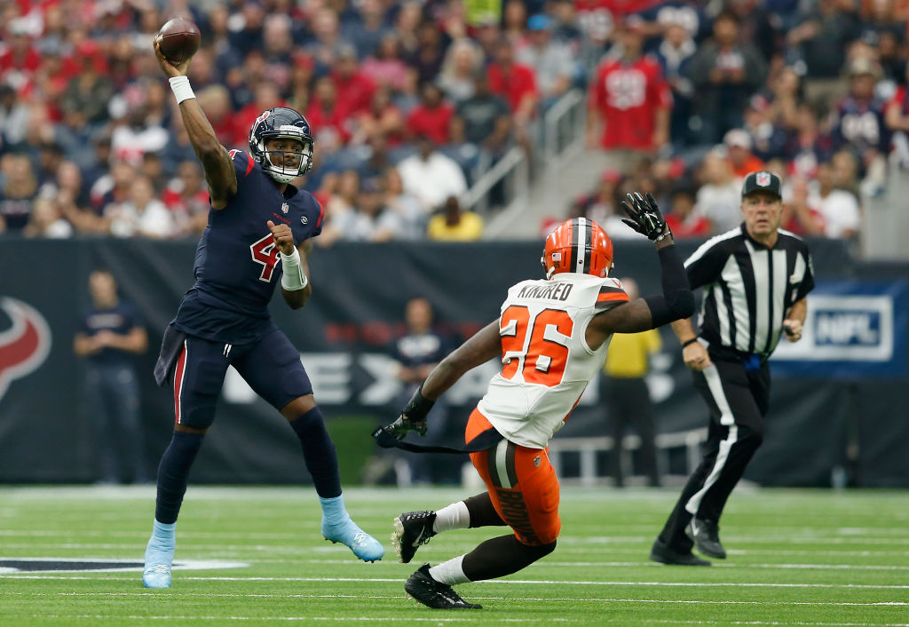 Deshaun Watson #4 of the Houston Texans throws the ball pressured by Derrick Kindred #26 of the Cleveland Browns in the second quarter at NRG Stadium on December 2, 2018 in Houston, Texas.