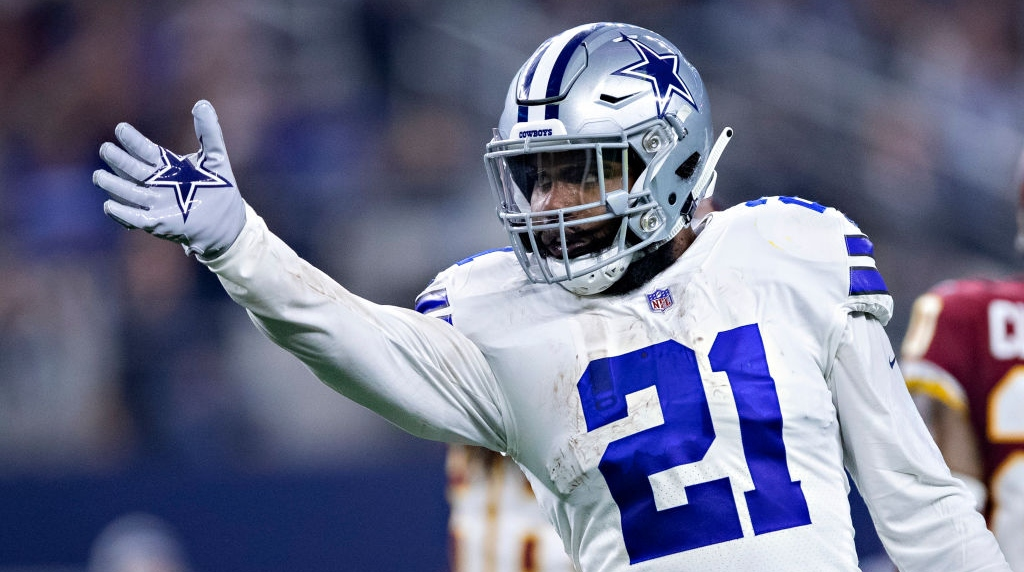 Ezekiel Elliott #21 of the Dallas Cowboys signals first down in the second half of a game against the Washington Redskins at AT&T Stadium on November 22, 2018 in Arlington, Texas. The Cowboys defeated the Redskins 31-23.