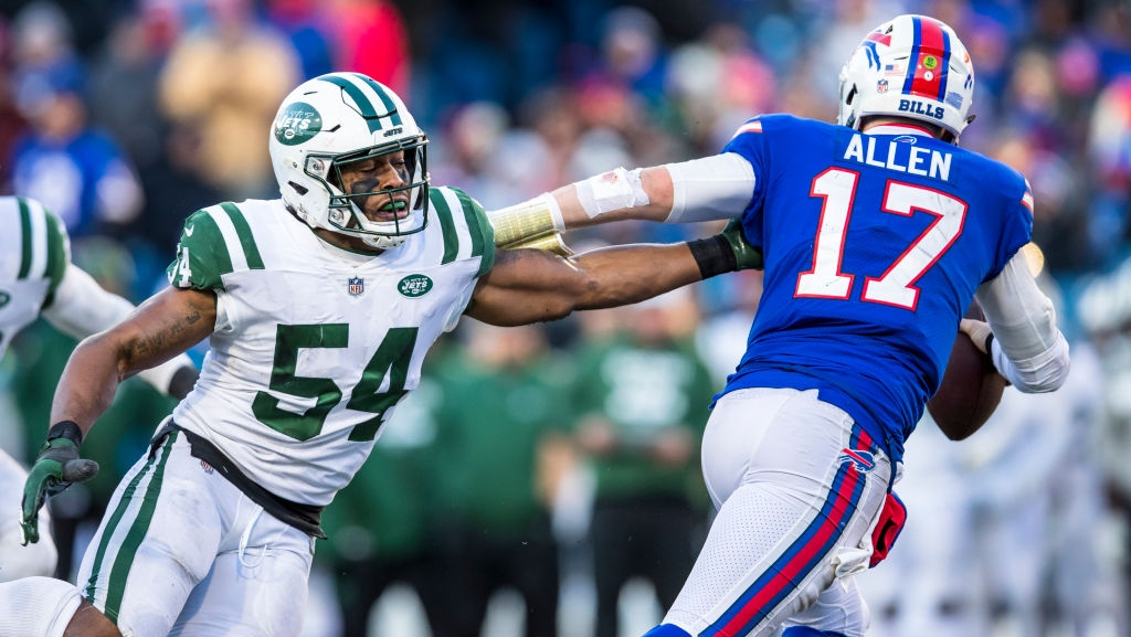Josh Allen #17 of the Buffalo Bills avoids a sack attempt by Avery Williamson #54 of the New York Jets during the third quarter at New Era Field on December 9, 2018 in Orchard Park, New York. New York defeats Buffalo 27-23.