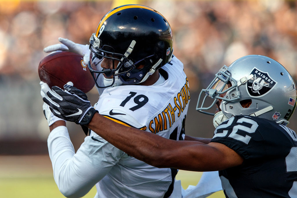 Wide receiver JuJu Smith-Schuster #19 of the Pittsburgh Steelers catches a pass in front of cornerback Rashaan Melvin #22 of the Oakland Raiders during the second quarter at O.co Coliseum on December 9, 2018 in Oakland, California.