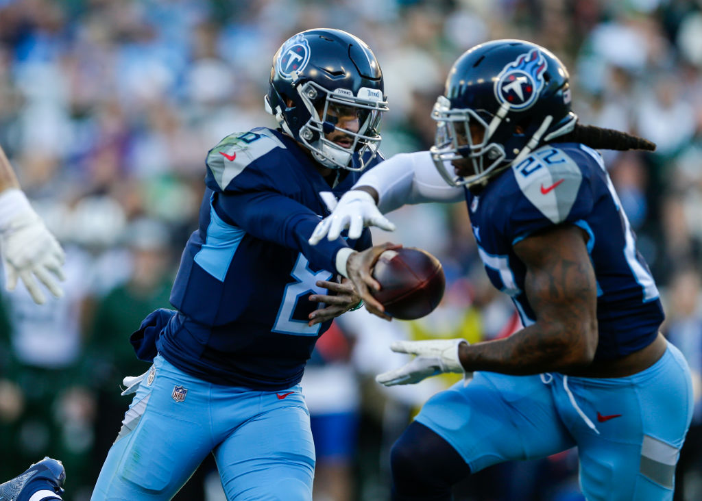 Marcus Mariota #8 of the Tennessee Titans hands off the ball to Derrick Henry at Nissan Stadium on December 2, 2018 in Nashville, Tennessee.