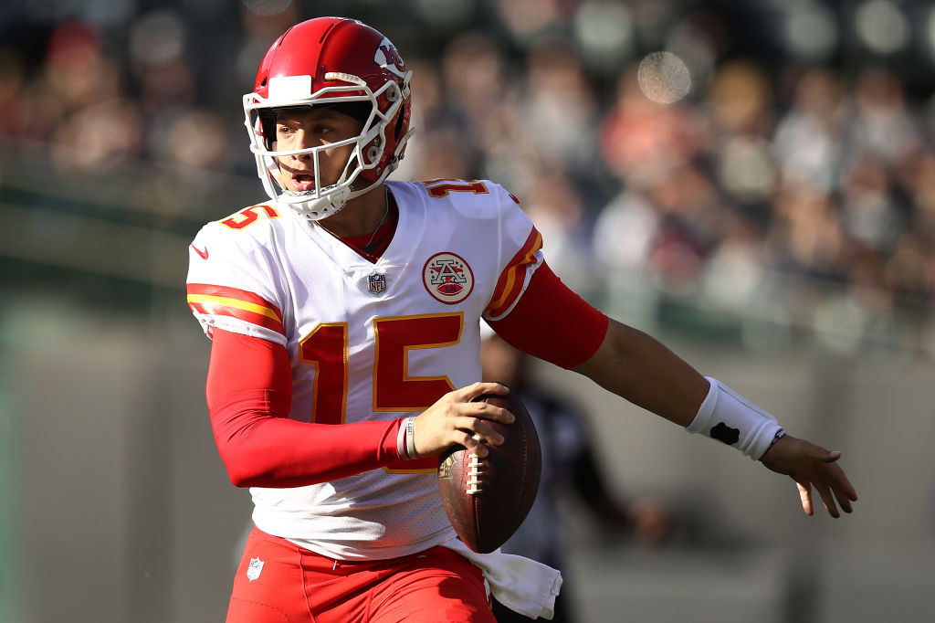 Patrick Mahomes #15 of the Kansas City Chiefs scrambles with the ball against the Oakland Raiders during their NFL game at Oakland-Alameda County Coliseum on December 2, 2018 in Oakland, California.