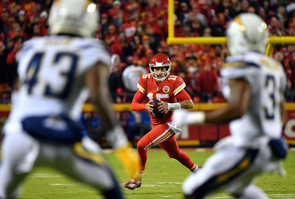 Quarterback Patrick Mahomes #15 of the Kansas City Chiefs scrambles during the game against the Los Angeles Chargers at Arrowhead Stadium on December 13, 2018 in Kansas City, Missouri.