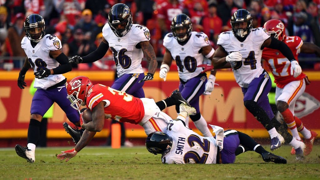 Running back Spencer Ware #32 of the Kansas City Chiefs carries the ball as cornerback Jimmy Smith #22 of the Baltimore Ravens defends during the game at Arrowhead Stadium on December 09, 2018 in Kansas City, Missouri.