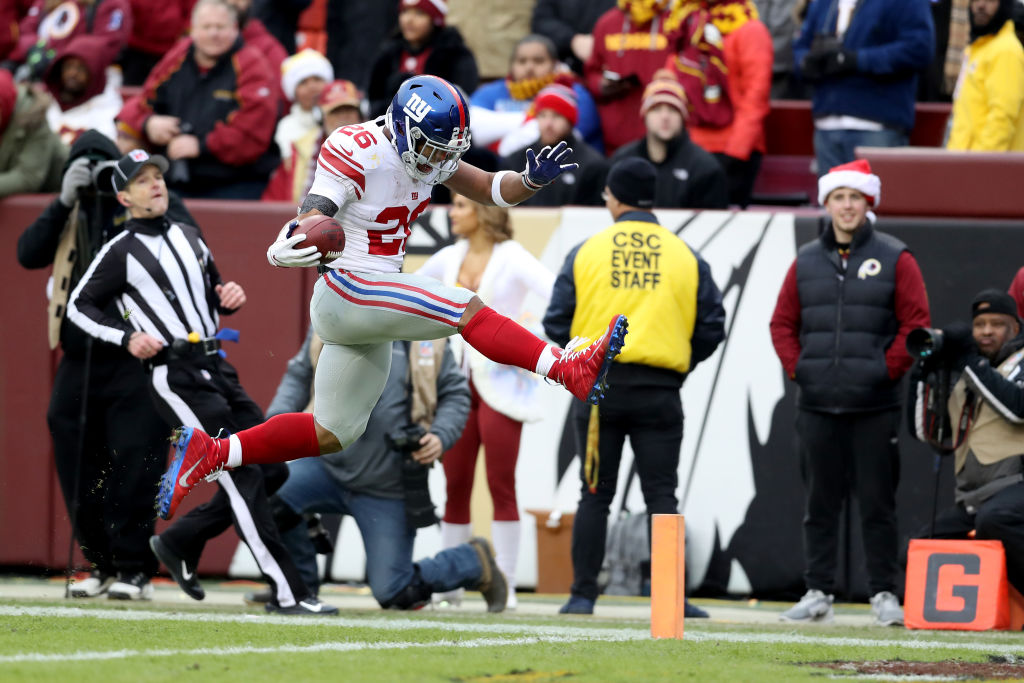 Running back Saquon Barkley #26 of the New York Giants celebrates while rushing for a first half touchdown against the Washington Redskins at FedExField on December 09, 2018 in Landover, Maryland.
