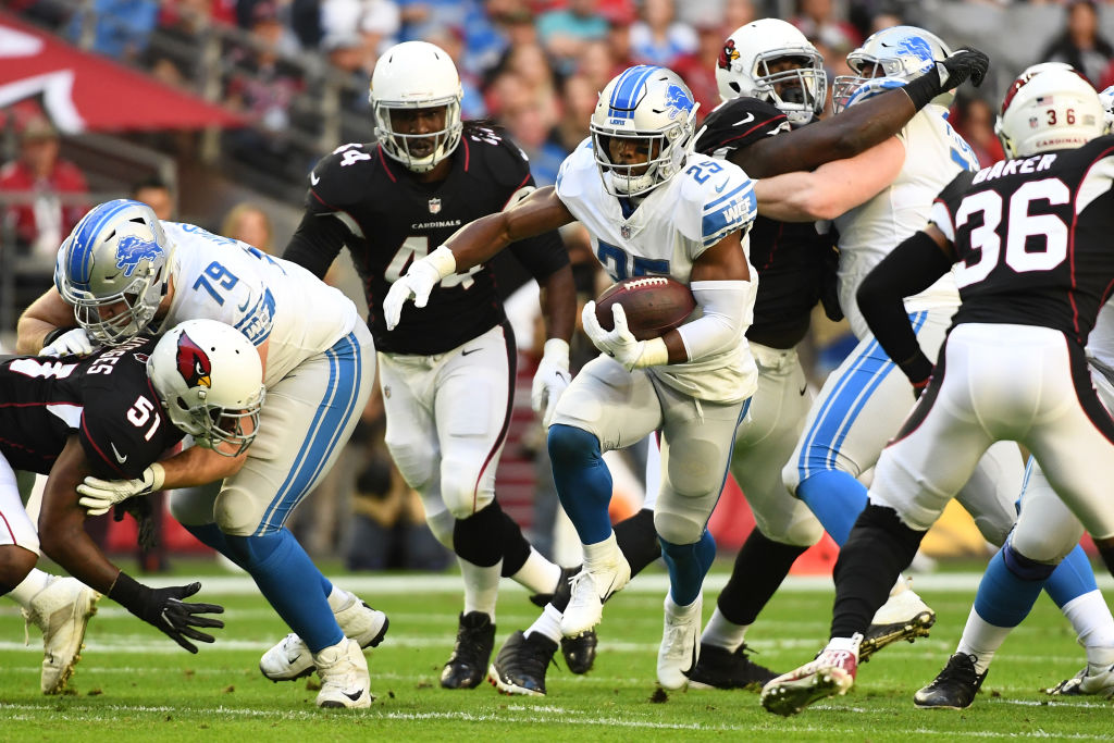 Theo Riddick #25 of the Detroit Lions runs with the ball in the first half of the NFL game against the Arizona Cardinals at State Farm Stadium on December 09, 2018 in Glendale, Arizona.